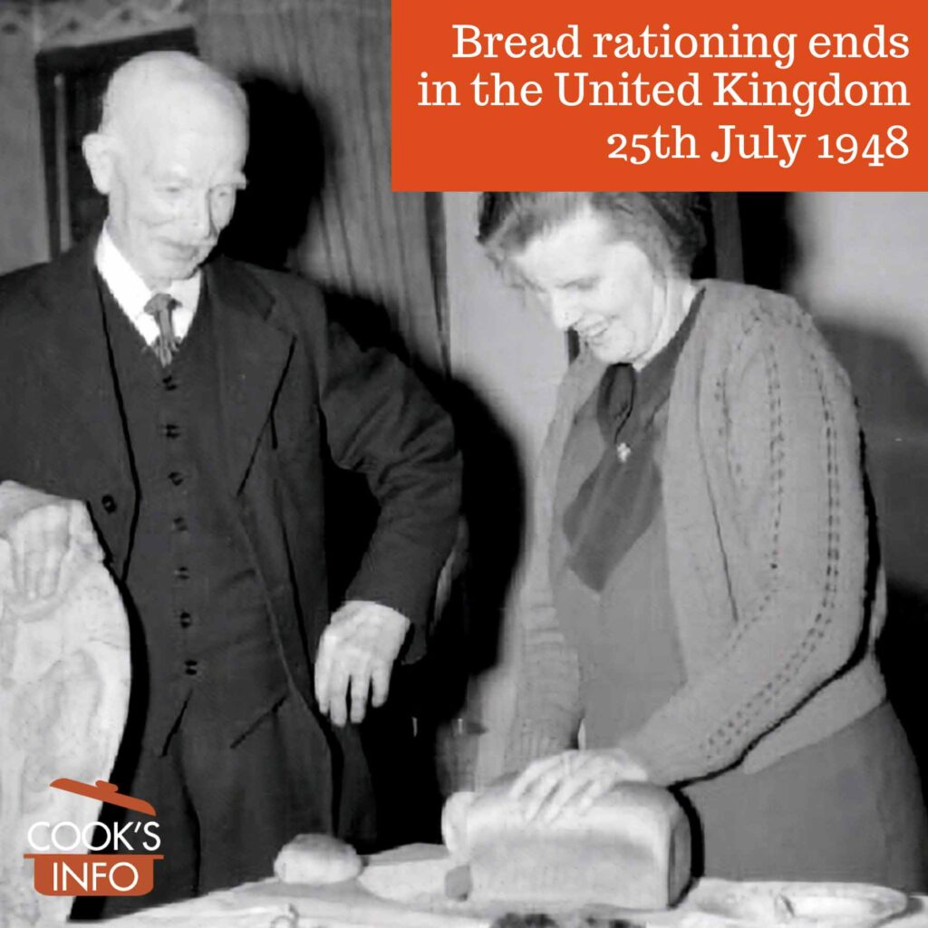 Slicing a loaf of unrationed bread in 1943, Yorkshire, England