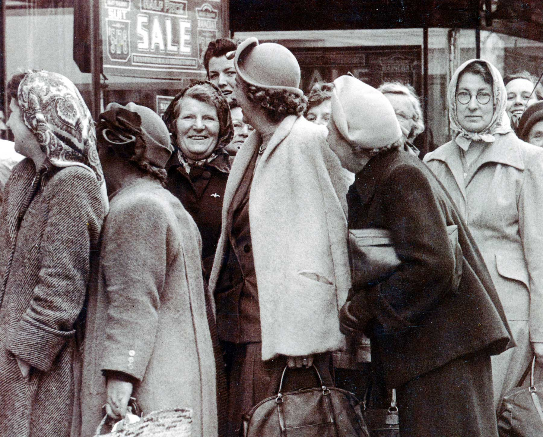 Shoppers queue in Bristol, England in the 1950s