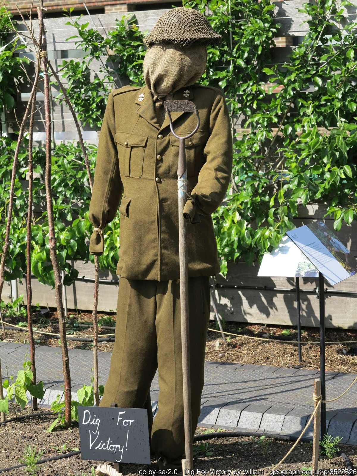 Solider mannequin digging in a garden