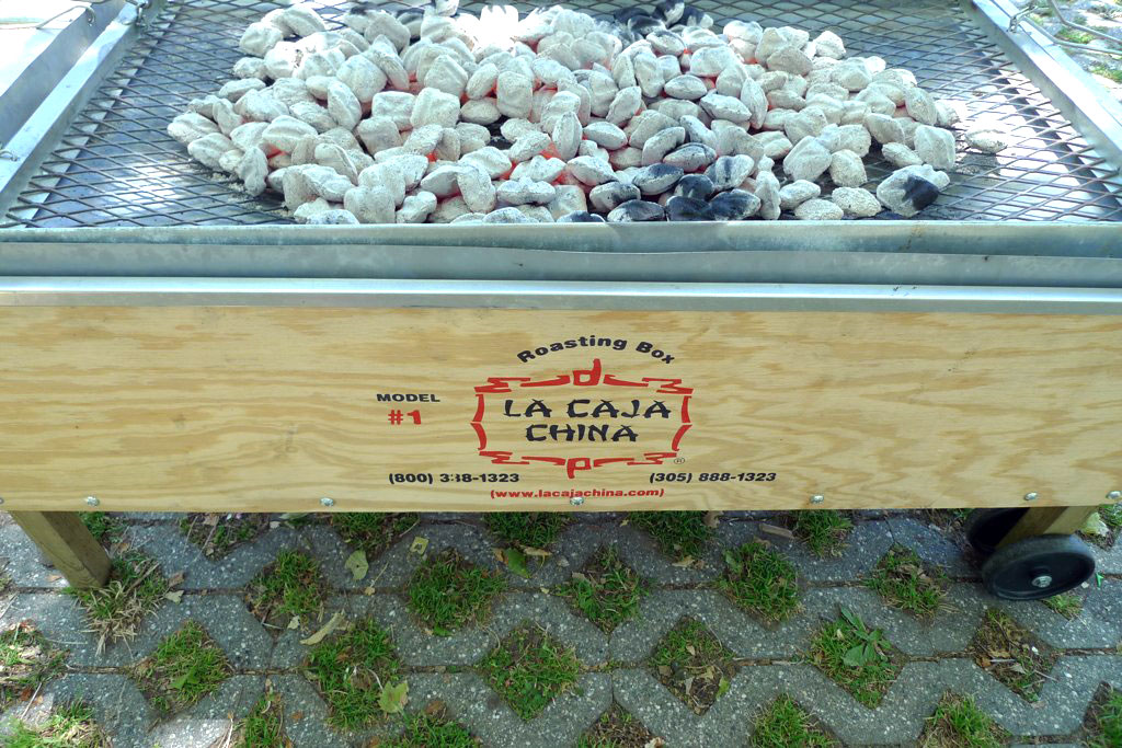 Caja China with coals on top