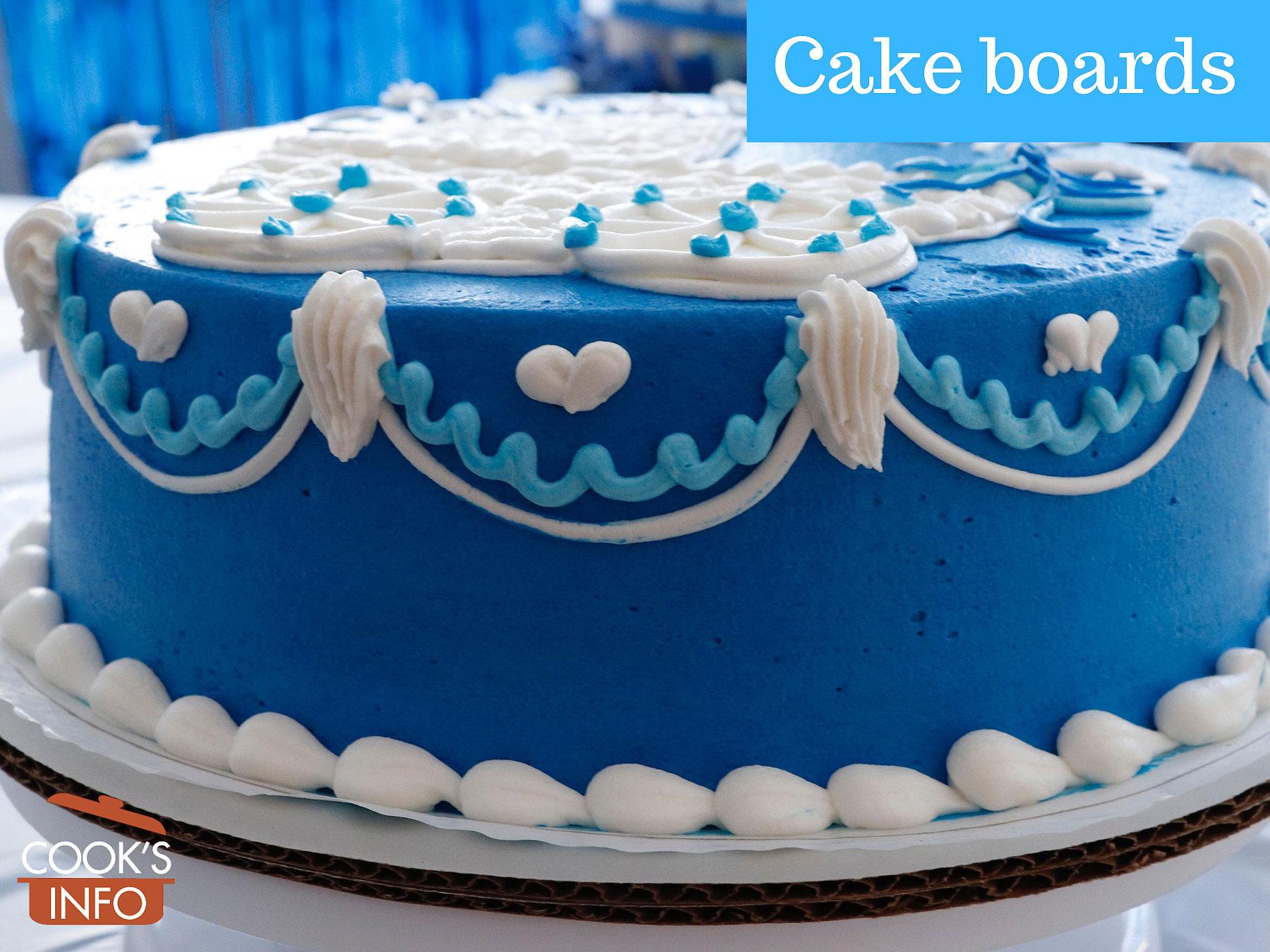 Blue cake on corrugated cardboard cake board