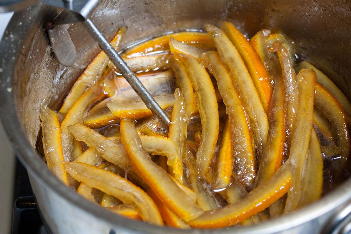 Orange peel simmering in sugar syrup