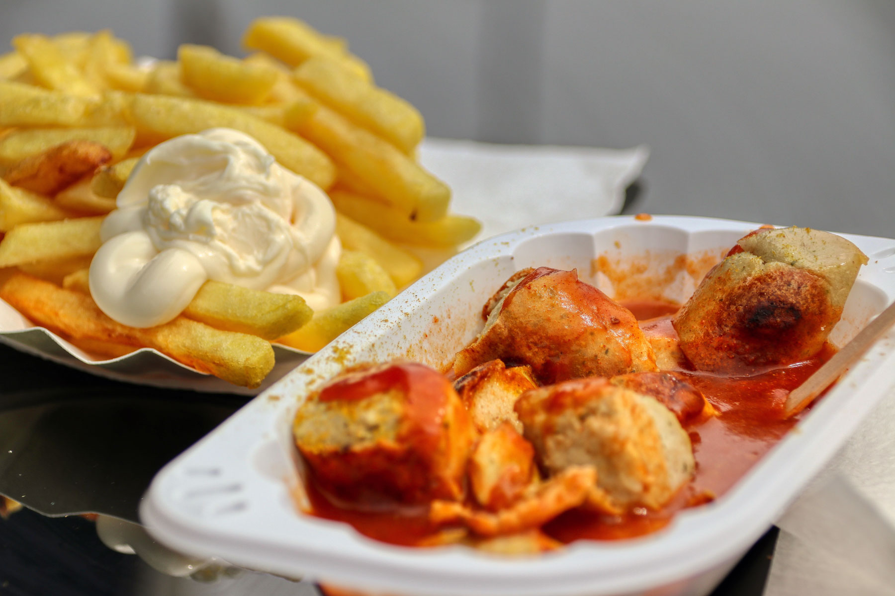Currywurst with fries and mayonnaise