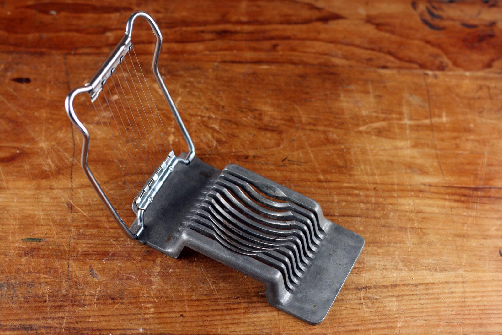 Metal egg slicer