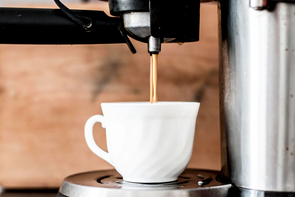 Espresso streaming into a cup