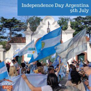 Crowd of people waving Argentine flags