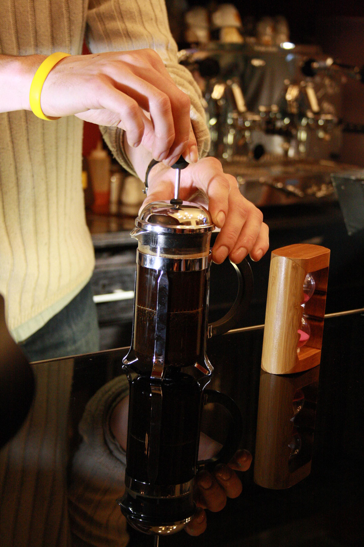 French press coffee maker in use.