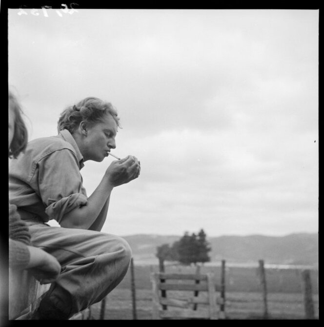 New Zealand land girl, Carol Sladden, having a cigarette, 1943.