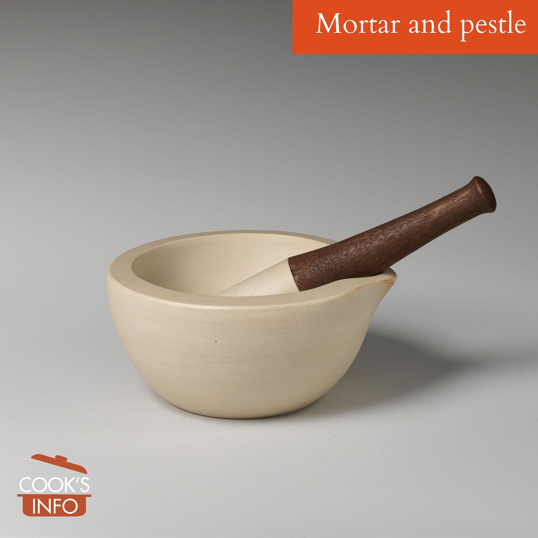Mortar and pestle of unglazed fine stoneware, wood