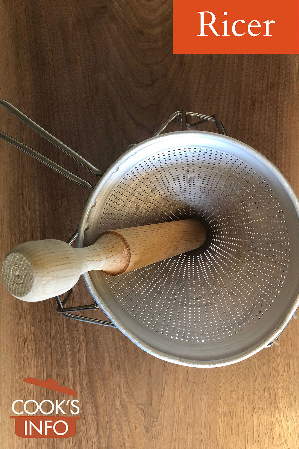 Ricer in stand with pestle, top view