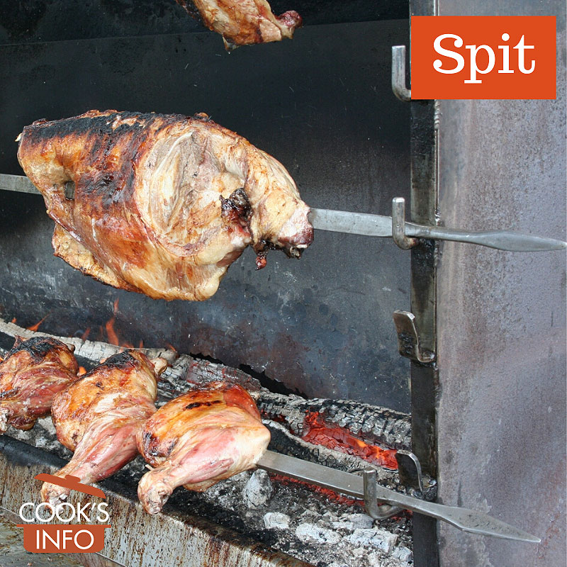 Spits in outdoor market in Lessay, France