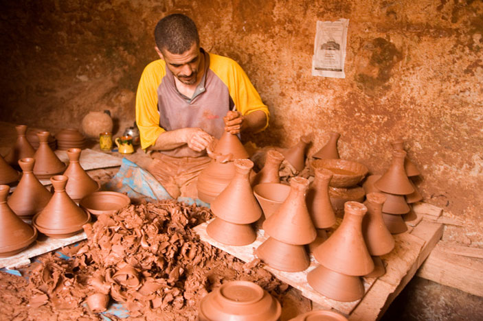 Tagines being formed by a potter