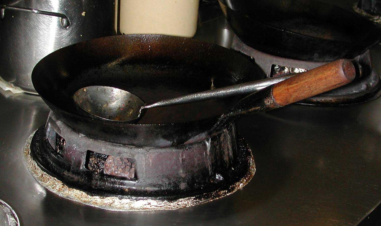 Wok on wok ring.