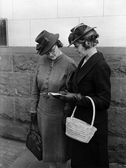Auckland women examine the new rations book. 1942.