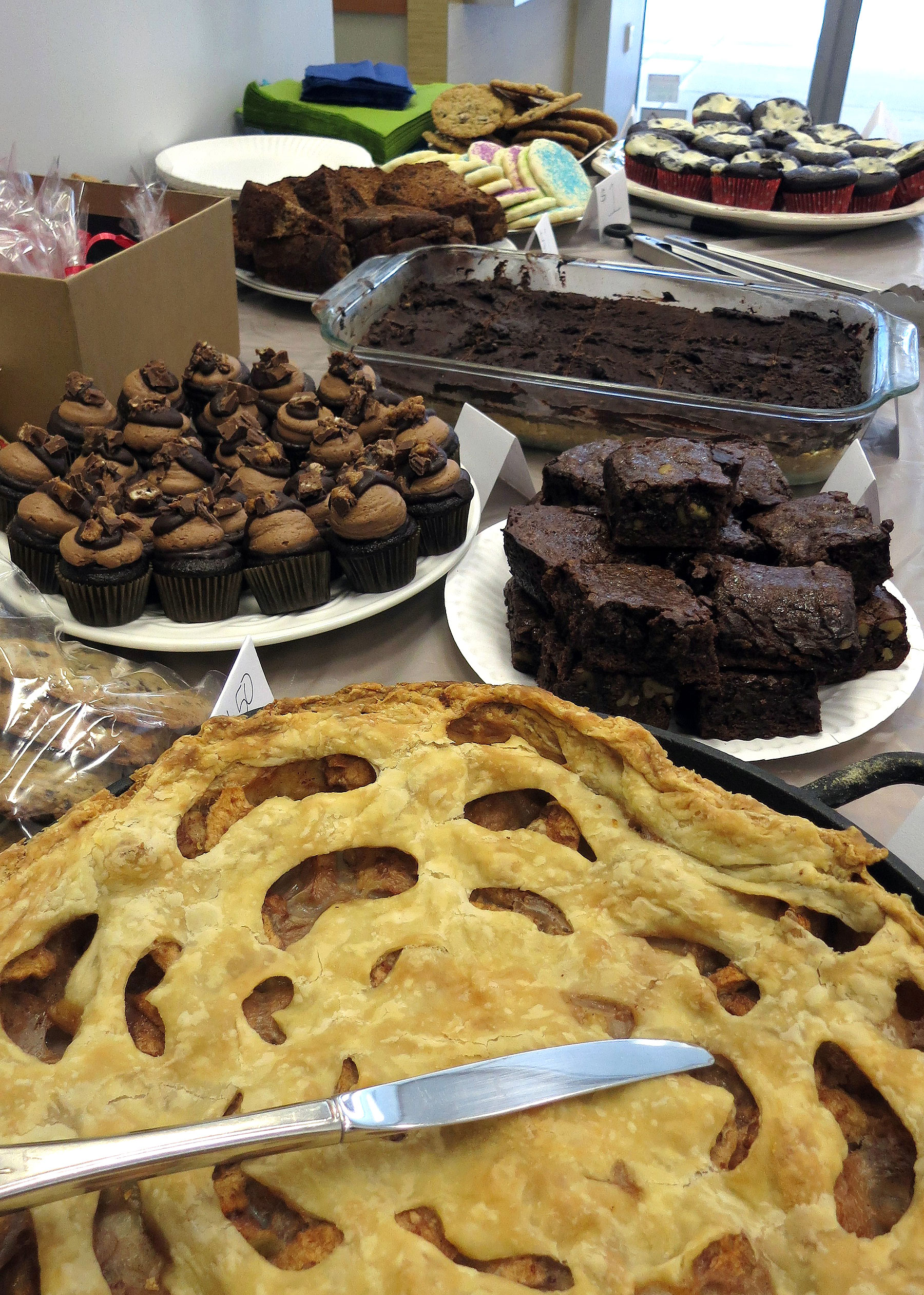 Bake sale in Vancouver, Canada, with various desserts including pie, brownies and cupcakes