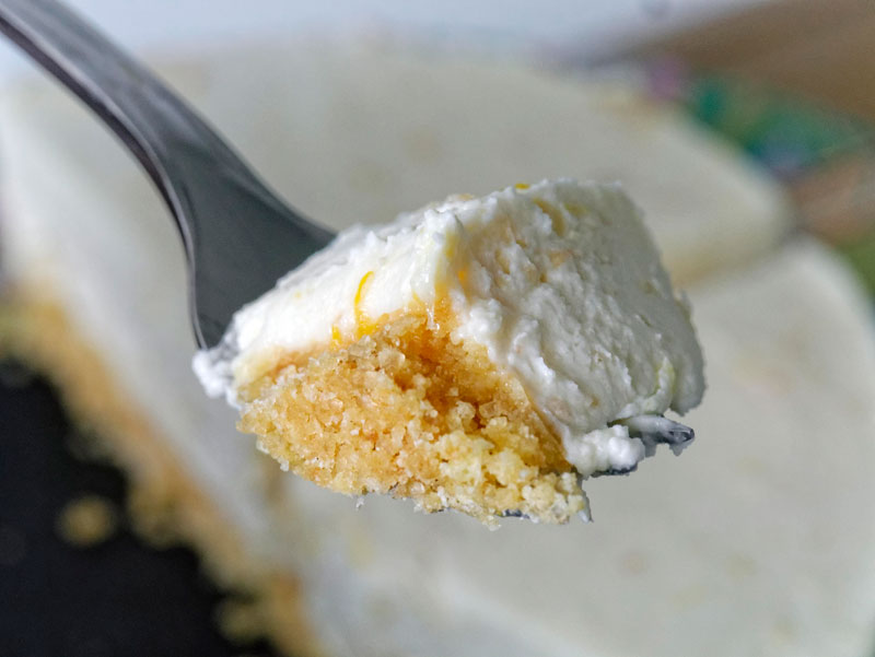A forkful of cheesecake with crumb crust