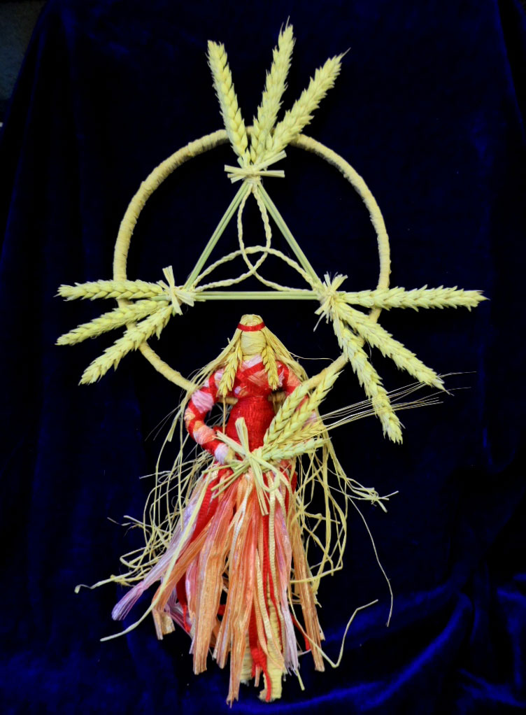 Celtic corn goddess dolly representing Taillitu, with Celtic Trinity symbol