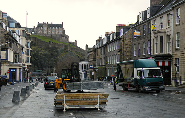 Forklift lifting crowd control barriers in Edinburgh