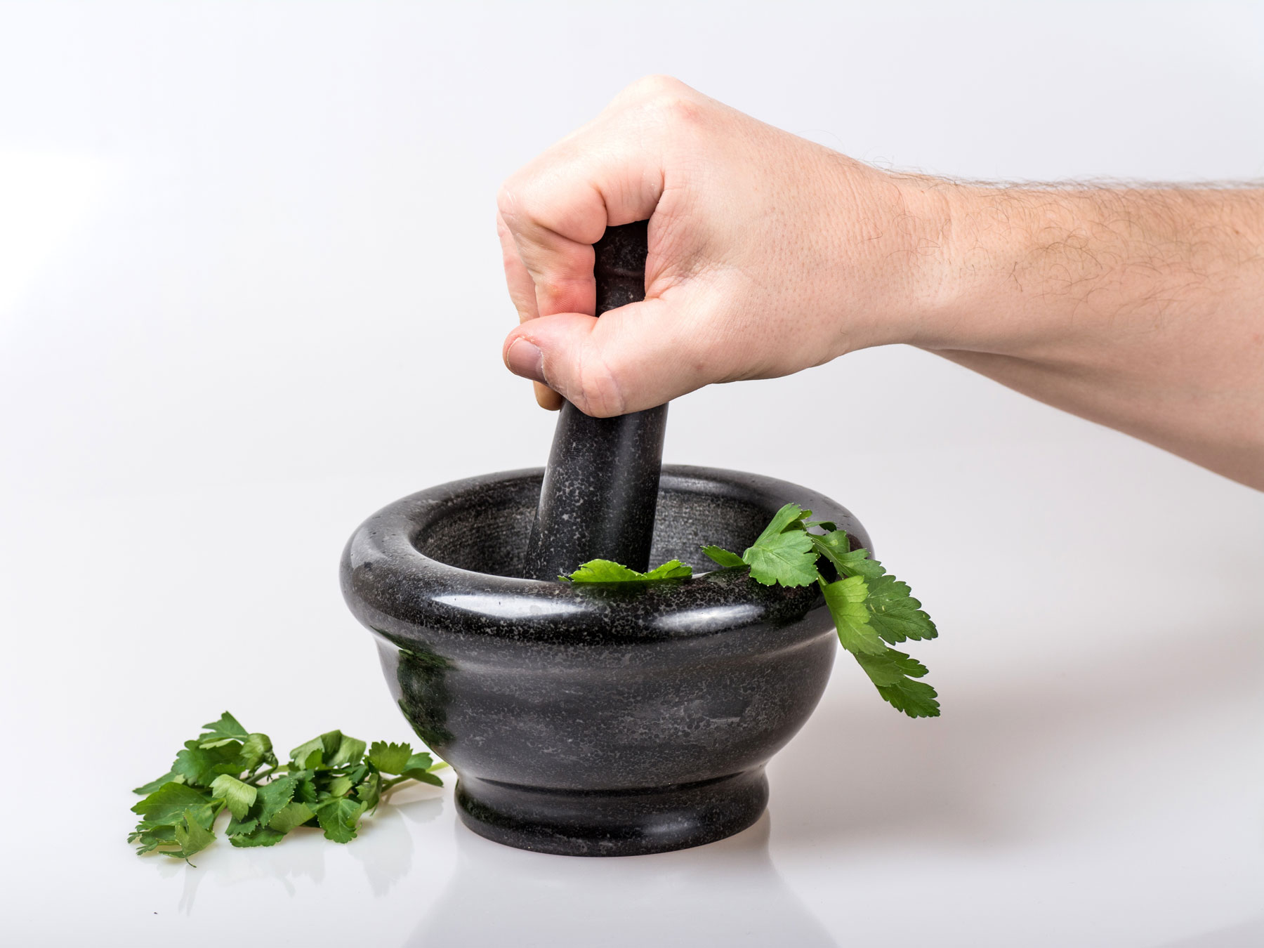Mortar and pestle crushing herbs