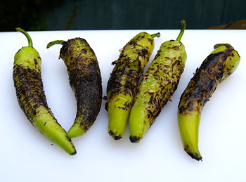 Flame-charred peppers ready for peeling