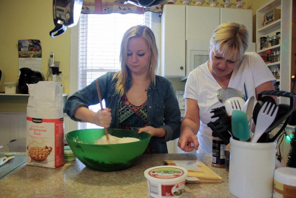 Stirring fruitcake batter