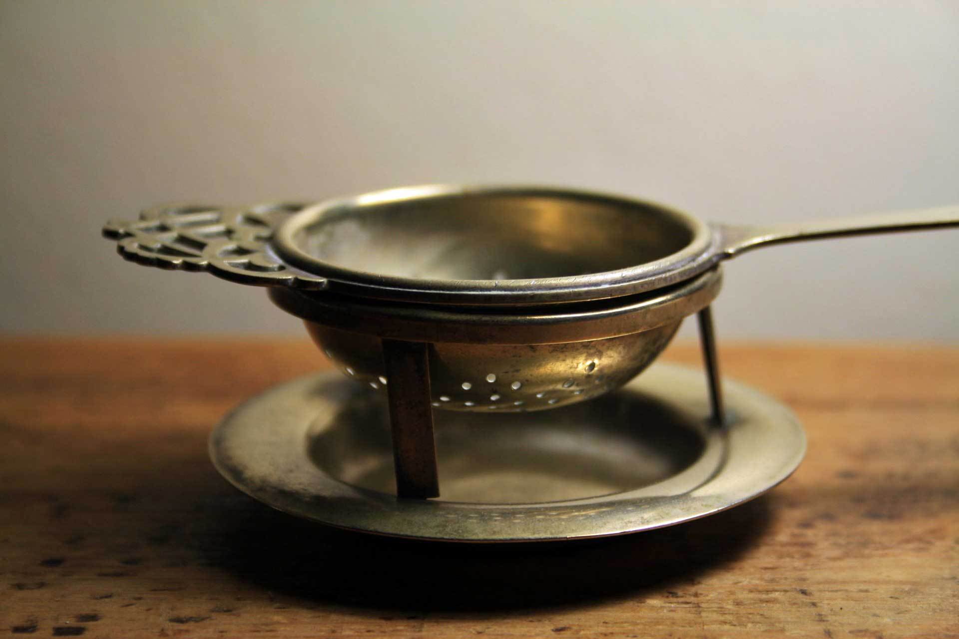 Brass tea strainer with stand