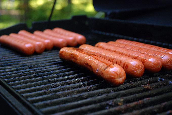 Wiieners cooking on a grill